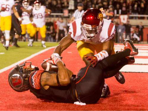 Rick Egan  |  The Salt Lake Tribune   USC Trojans safety Elijah Steen (24) jumps on Ute wide receiver Kaelin Clay (8) as he holds onto the pass that gave the Utes a 24-21 victory over the USC Trojans at Rice-Eccles Stadium, Saturday, October 25, 2014.