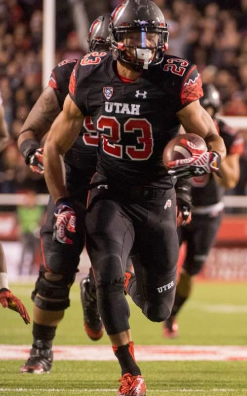 Rick Egan  |  The Salt Lake Tribune  Utah Utes running back Devontae Booker (23) runs for a third-quarter touchdown in Pac-12 action, Utah vs. USC, at Rice-Eccles Stadium, Saturday, October 25, 2014.