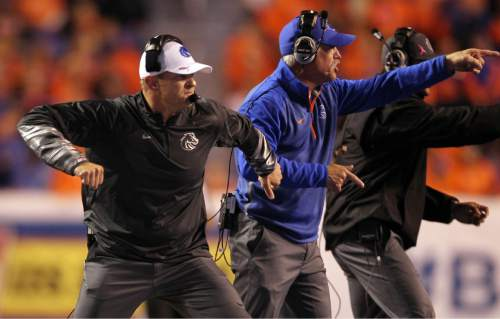 Boise State coaches, including head coach Bryan Harsin, left, celebrate a defensive stop against BYU during an NCAA college football game in Boise, Idaho, Friday, Oct. 24, 2014. (AP Photo/The Idaho Statesman, Kyle Green) MANDATORY CREDIT; LOCAL TELEVISION OUT (KTVB 7)
