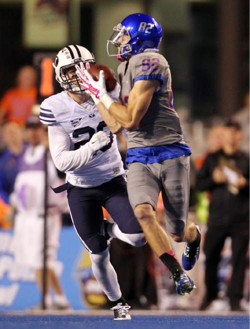 Boise State wide receiver Thomas Sperbeck (82) makes a first-half touchdown reception against BYU during an NCAA college football game in Boise, Idaho, Friday, Oct. 24, 2014. (AP Photo/The Idaho Statesman, Kyle Green) MANDATORY CREDIT; LOCAL TELEVISION OUT (KTVB 7)