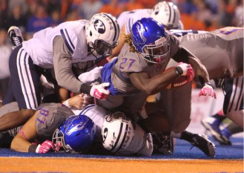 Boise State running back Jay Ajayi stretches for a touchdown in the first half against BYU during an NCAA college football game in Boise, Idaho, Friday, Oct. 24, 2014. (AP Photo/The Idaho Statesman, Kyle Green) MANDATORY CREDIT; LOCAL TELEVISION OUT (KTVB 7)