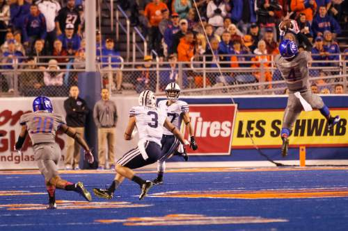 Boise State safety Darian Thompson (4) intercepts a pass during the second quarter of an NCAA college football game against BYU in Boise, Idaho, Friday, Oct. 24, 2014. (AP Photo/Otto Kitsinger)