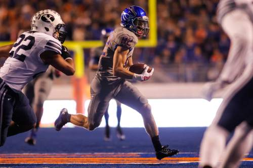 Boise State wide receiver Thomas Sperbeck (82) runs the ball during the first quarter of an NCAA college football game against BYU in Boise, Idaho, Friday, Oct. 24, 2014. (AP Photo/Otto Kitsinger)