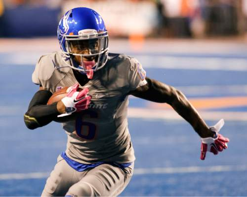 Boise State wide receiver Chaz Anderson (6) runs the ball during the first quarter of an NCAA college football game against BYU in Boise, Idaho, Friday, Oct. 24, 2014. (AP Photo/Otto Kitsinger)