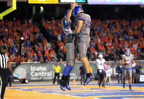 Boise State quarterback Grant Hedrick (9) celebrates with wide receiver Thomas Sperbeck (82) after Hedrick's first-half touchdown against BYU during an NCAA college football game in Boise, Idaho, Friday, Oct. 24, 2014. (AP Photo/The Idaho Statesman, Kyle Green) MANDATORY CREDIT; LOCAL TELEVISION OUT (KTVB 7)