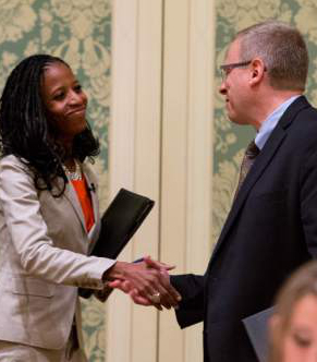 Trent Nelson     The Salt Lake Tribune Utah 4th Congressional District Candidates Mia Love and Doug Owens shake hands before their debate at the annual Utah Taxes Now Conference at the Grand America Hotel in Salt Lake City Tuesday May 20, 2014.