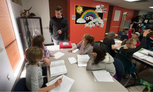 Steve Griffin  |  The Salt Lake Tribune  Nate Rickett works on ratios with his sixth-grade math class at the Salt Lake Arts Academy in Salt Lake City, Monday, October 27, 2014. The school was one of the charter schools that scored above the state average in all test subjects.