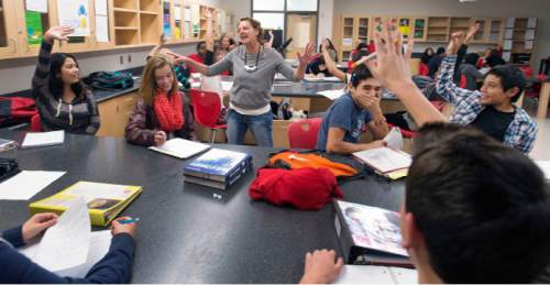 Steve Griffin  |  The Salt Lake Tribune  Susan Atkin works with students in her 10th-grade Core Chemistry class at Granger High School in West Valley City, Friday, October 24, 2014.