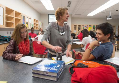 Steve Griffin  |  The Salt Lake Tribune  Susan Atkin stamps work from her students Sydney Bell and David Sanchez in her 10th-grade Core Chemistry class at Granger High School in West Valley City, Friday, October 24, 2014.