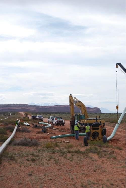 Brian Maffly  |  The Salt Lake Tribune A crew assembles and installs a pipeline to move natural gas from Fidelity Exploration and Production Co.'s operations on Big Flat, a scenic recreational area outside Moab. This lateral line was completed last May and the company is poised to begin construction this month on a 26-mile network of gathering lines connecting with 19 well pads  in the Cane Creek oil field.