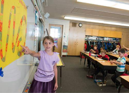 Rick Egan  |  The Salt Lake Tribune  Caroline Pace gives her Creative Credit presentation, in Sonja Aoki's 4th grade class at Morningside Elementary School, in Holladay, Monday, October 27, 2014.