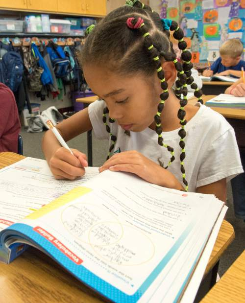 Rick Egan  |  The Salt Lake Tribune  Isa Barker works on her math in Sonja Aoki's 4th grade class at Morningside Elementary School, in Holladay, Monday, October 27, 2014.