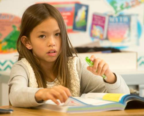Rick Egan  |  The Salt Lake Tribune  Chloe Tien listens as her teacher, Sonja Aoki teaches math in her 4th grade class at Morningside Elementary School, in Holladay, Monday, October 27, 2014.