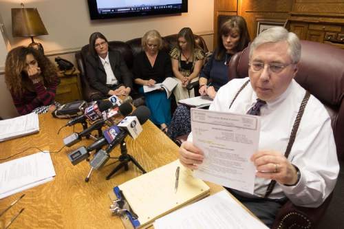 Trent Nelson  |  The Salt Lake Tribune Attorney Robert Sykes holds the official autopsy of Darrien Hunt, who was shot to death Sept. 10 by Saratoga Springs police. Sykes, along with Darrien's mother Susan Hunt, spoke to reporters at a press conference in Salt Lake City, Tuesday October 28, 2014.