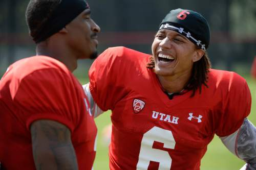 Francisco Kjolseth  |  The Salt Lake Tribune Wide receivers Kenneth Scott, left, and Dres Anderson joke with one another during an interview following the Utes first full contact practice with all pads.
