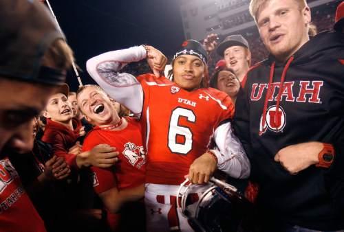 Scott Sommerdorf   |  The Salt Lake Tribune Utah WR Dres Anderson (6) celebrates with fans on the field after Utah upset #5 Stanford 27-21, Saturday, October 12, 2013.