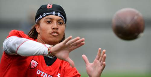 Steve Griffin  |  The Salt Lake Tribune   University of Utah receiver Dres Anderson catches passes thrown from a machine following football practice on the campus of the University of Utah in Salt Lake City, Friday, August 22, 2014.