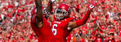 Trent Nelson  |  The Salt Lake Tribune Utah Utes wide receiver Dres Anderson (6) celebrates a touchdown with teammate Kenneth Scott, left, as Utah hosts Fresno State, college football at Rice-Eccles Stadium Saturday September 6, 2014.