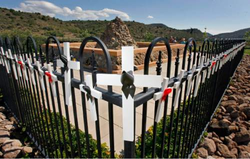 Wooden crosses adorn the black wrought iron fence that surrounds the Mountain Meadows Massacre Grave Site Memorial near Enterprise, UT Sept. 7, 2007.  Steve Griffin/The Salt Lake Tribune 9/10/07