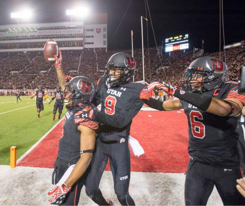 Rick Egan  |  The Salt Lake Tribune   Utah Utes wide receiver Kaelin Clay (8) celebrates with wide receiver Tim Patrick (9) and Utah Utes wide receiver Dres Anderson (6) after scoring the game-winning touchdown, with 8 seconds left in the game, giving the Utes a 24-21 victory of the USC Trojans in Pac-12 action at Rice-Eccles Stadium, Saturday, October 25, 2014.