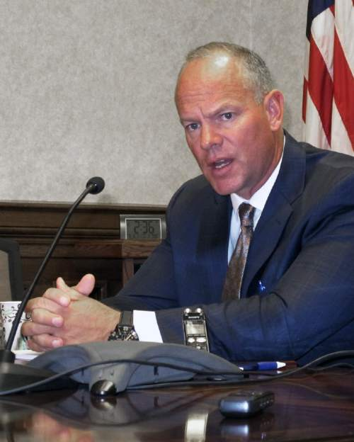 Wyoming Gov. Matt Mead addresses reporters at a news conference at the state Capital in Cheyenne Thursday, Sept. 25, 2014. (AP Photo/Ben Neary)