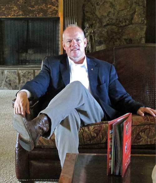 In this Oct. 8, 2014 photo, Wyoming Gov. Matt Mead sits in the living room of the governor's mansion in Cheyenne. Mead, a Republican, is running for re-election and faces challenges from Democrat Pete Gosar, Libertarian Dee Cozzens and independent Don Wills. (AP Photo/Ben Neary)