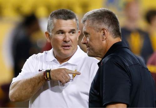 Arizona State head coach Todd Graham, left, talks with Utah head coach Kyle Wittingham prior to an NCAA college football game on Saturday, Nov. 1, 2014, in Tempe, Ariz. (Photo/Ross D. Franklin)