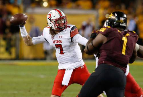 Utah's Travis Wilson (7) gets off a pass as Arizona State's Marcus Hardison (1) tries to pressure the quarterback in the first half of an NCAA college football game on Saturday, Nov. 1, 2014, in Tempe, Ariz. (Photo/Ross D. Franklin)