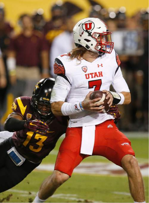 Arizona State's Armand Perry (13) sacks Utah's Travis Wilson in the first half of an NCAA college football game on Saturday, Nov. 1, 2014, in Tempe, Ariz. (Photo/Ross D. Franklin)