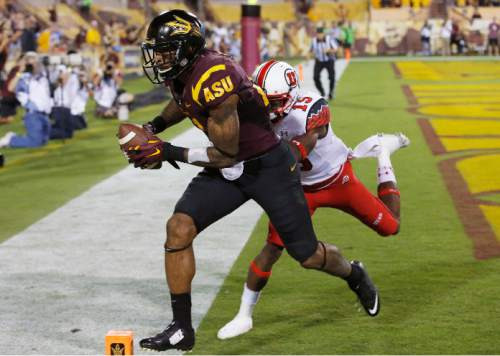 Arizona State's Jaelen Strong, left, makes a touchdown catch as Utah's Dominique Hatfield (15) defends in the first half of an NCAA college football game on Saturday, Nov. 1, 2014, in Tempe, Ariz. (Photo/Ross D. Franklin)