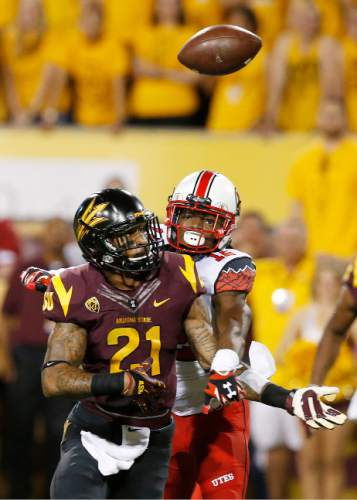Utah's Justin Thomas (12) breaks up a pass intended for Arizona State's Jaelen Strong (21) in the first half of an NCAA college football game on Saturday, Nov. 1, 2014, in Tempe, Ariz. (Photo/Ross D. Franklin)