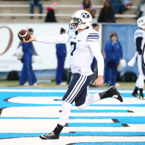 "Courtesy  |  Mark A. Philbrick, BYU BYU quarterback Christian Stewart scores a touchdown in the fourth quarter. BYU defeated Middle Tennessee by a score of 27-7 at Johnny ""Red"" Floyd Stadium in Murfreesboro, Tenn., Saturday, Nov. 1, 2014."