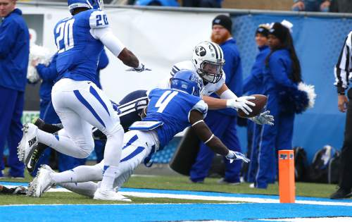 "Courtesy  |  Mark A. Philbrick, BYU BYU wide receiver Colby Pearson scores a touchdown in the first quarter. BYU defeated Middle Tennessee by a score of 27-7 at Johnny ""Red"" Floyd Stadium in Murfreesboro, Tenn., Saturday, Nov. 1, 2014."