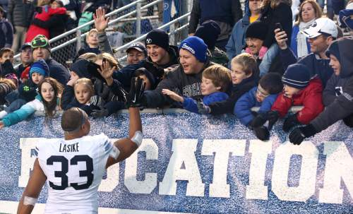 "Courtesy  |  Mark A. Philbrick, BYU BYU running back Paul Lasike celebrates with fans after the win. BYU defeated Middle Tennessee by a score of 27-7 at Johnny ""Red"" Floyd Stadium in Murfreesboro, Tenn., Saturday, Nov. 1, 2014."