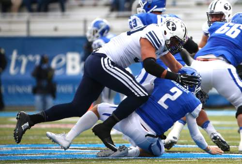 "Courtesy  |  Mark A. Philbrick, BYU BYU Bronson Kaufusi sacks Middle Tennessee Quarterback Austin Grammar. BYU defeated Middle Tennessee by a score of 27-7 at Johnny ""Red"" Floyd Stadium in Murfreesboro, Tenn., Saturday, Nov. 1, 2014."