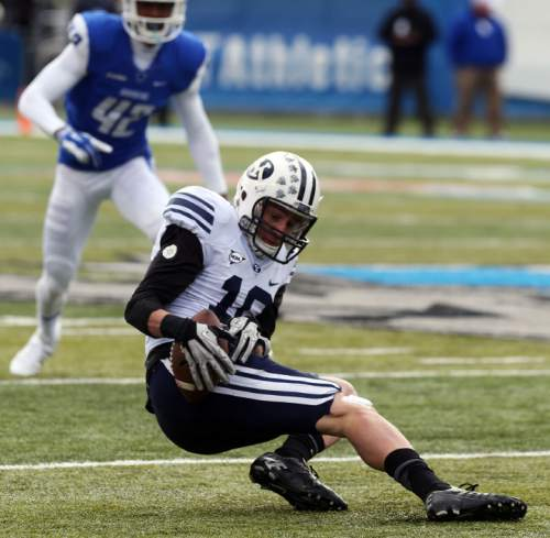 BYU receiver Mitch Mathews pulls in a pass against Middle Tennessee in the first quarter of the NCAA college football game Saturday, Nov. 1, 2014, at Middle Tennessee in Murfreesboro, Tenn. (AP Photo/The Daily News Journal, John A. Gillis) NO SALES