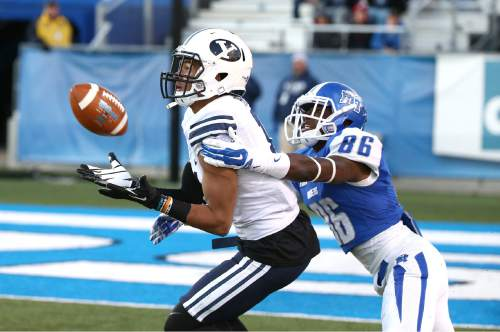 "Courtesy  |  Mark A. Philbrick, BYU BYU's Jordan Preator intercepts the football in front of Middle Tennessee's  Devin Clark. BYU defeated Middle Tennessee by a score of 27-7 at Johnny ""Red"" Floyd Stadium in Murfreesboro, Tenn., Saturday, Nov. 1, 2014."