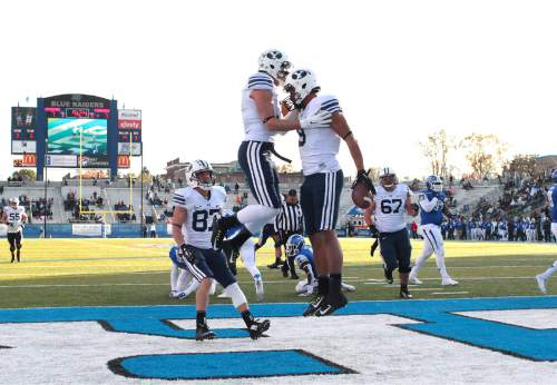 "Courtesy  |  Mark A. Philbrick, BYU BYU Wide Receiver Jordan Leslie (9) celebrates his touchdown against Middle Tennessee. BYU defeated Middle Tennessee by a score of 27-7 at Johnny ""Red"" Floyd Stadium in Murfreesboro, Tenn., Saturday, Nov. 1, 2014."