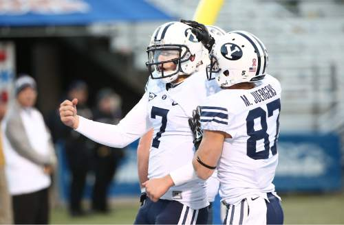 "Courtesy  |  Mark A. Philbrick, BYU BYU quarterback Christian Stewart celebrates his touchdown in the fourth quarter. BYU defeated Middle Tennessee by a score of 27-7 at Johnny ""Red"" Floyd Stadium in Murfreesboro, Tenn., Saturday, Nov. 1, 2014."