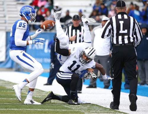 "Courtesy  |  Mark A. Philbrick, BYU BYU's Jordan Preator knocks the ball loose. BYU defeated Middle Tennessee by a score of 27-7 at Johnny ""Red"" Floyd Stadium in Murfreesboro, Tenn., Saturday, Nov. 1, 2014."