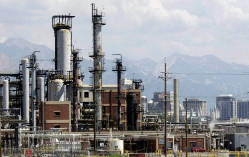 Downtown Salt Lake City can be seen in the background of this photo of the Tesoro refinery near 400 West and 900 North in Salt Lake City. Griffin/photo 07/15/04