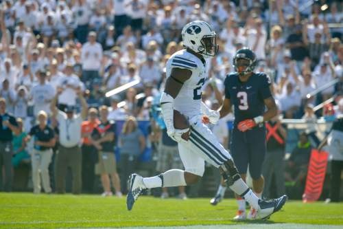 Chris Detrick  |  The Salt Lake Tribune Brigham Young Cougars running back Jamaal Williams (21) celebrates his touchdown run during the second half of the game at LaVell Edwards Stadium Saturday September 20, 2014.  BYU won the game 41-33.