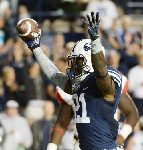 Steve Griffin  |  The Salt Lake Tribune   BYU Cougars running back Jamaal Williams (21) holds the football up after scoring a touchdown in the second half of the  game between BYU and Houston and LaVell Edwards Stadium in Provo, Thursday, September 11, 2014.