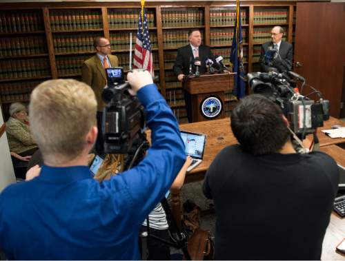 Steve Griffin  |  The Salt Lake Tribune  Utah County Attorney Jeffrey Buhman, center, addresses the media as he explains the Utah County Attorney's Office's ruling in the officer-involved shooting of Darrien Hunt during a press conference in Provo, Monday, November 3, 2014.