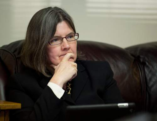 Lennie Mahler  |  The Salt Lake Tribune Karra Porter, attorney representing Curtis Hunt, listens during a press conference at Robert Sykes' law office in downtown Salt Lake City, Monday, Nov. 3, 2014, in response to the Utah County Attorney's announcement that Saratoga Springs Police officers were justified in the fatal shooting of Darrien Hunt on Sept. 10.