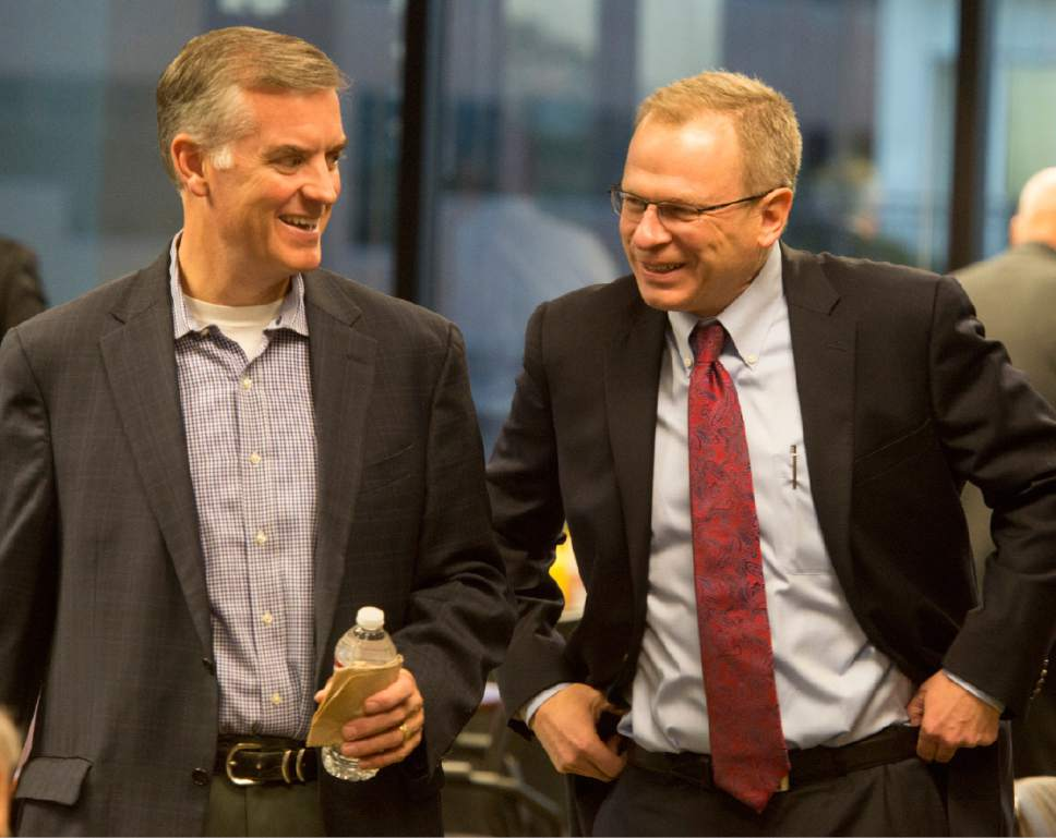 Rick Egan     The Salt Lake Tribune  Peter Corroon chats with 4th district candidate Doug Owens, Thursday, September 25, 2014.  Mia Love declined to participate in a joint event with Doug Owens.