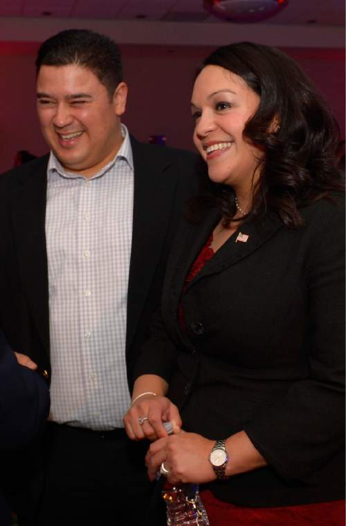 Leah Hogsten     The Salt Lake Tribune 2nd Congressional District, Luz Robles joined by her husband Juan Carlos Escamilla at the Utah Democratic Party headquarters at the Radisson Hotel in Salt Lake City, November 4, 2014.