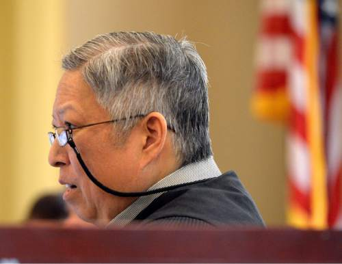 Al Hartmann  |  The Salt Lake Tribune Judge Michael Kwan listens as sixth-grade teacher Michelle Ferguson-Montgomery, enters a plea in abeyance in Taylorsville Justice Court on Wednesdy, November 5, 2014. She was charged with one count of discharge of a firearm in a prohibited area within city limits, a class B misdemeanor, for the Sept. 11, 2014, mishap.