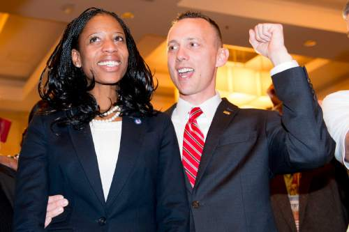 Steve Griffin  |  The Salt Lake Tribune  Mia Love celebrates with her husband Jason after defeating opponent Doug Owens in the race for Utah's 4th Congressional District, Tuesday November 4, 2014.