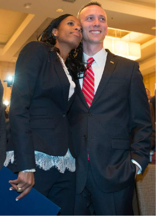 Steve Griffin  |  The Salt Lake Tribune  Mia Love stands with her husband, Jason, as she is introduced as the winner of her congressional race in Utah's 4th district  Salt Lake City, Wednesday, November 5, 2014.